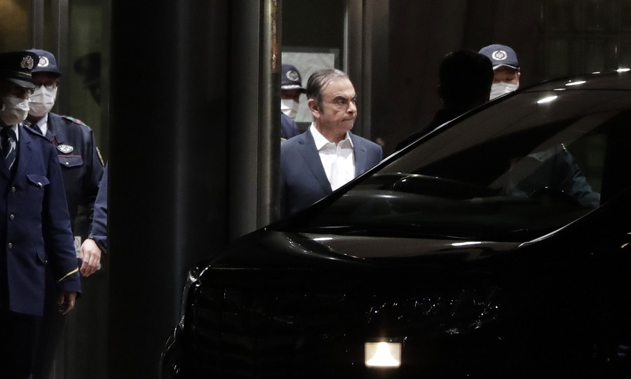 Ghosn freed from jail for second time, agrees to limit