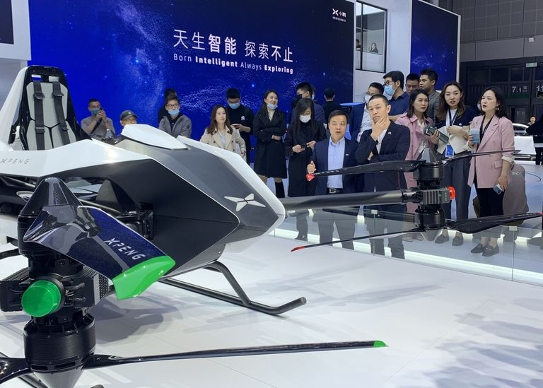 Nio CEO William Li, right, and Xpeng CEO He Xiaopeng, two leading lights of China's EV onslaught, staged a very public walk around of each other's booths at the Shanghai auto show on Monday.