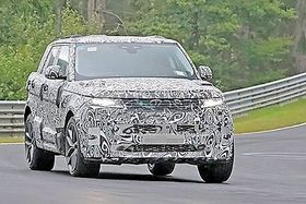 The new Range Rover has cleaner lines but keeps design cues such as the clamshell hood and sloping roof.