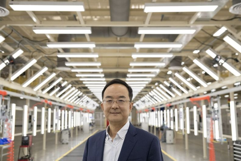 Andy Conghui An, president of Zhejiang Geely Holding Group Co., on the production line of the manufacturing plant for Zeekr, Geely's new EV unit, in Ningbo, Zhejiang province, on April 14, 2021.