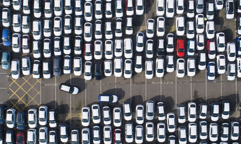 Cars parked at a depot before being transported to dealers