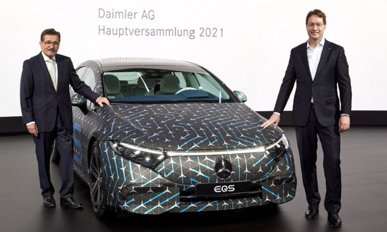 Daimler Chairman Manfred Bischoff, left, and CEO Ola Kallenius stand next to a Mercedes EQS ahead of the automaker's 2021 annual meeting on March 31.
