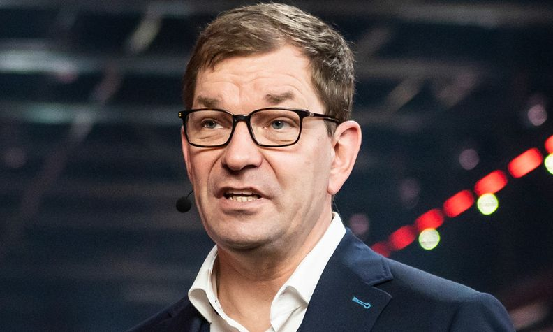Audi CEO Markus Duesmann speaking at an event