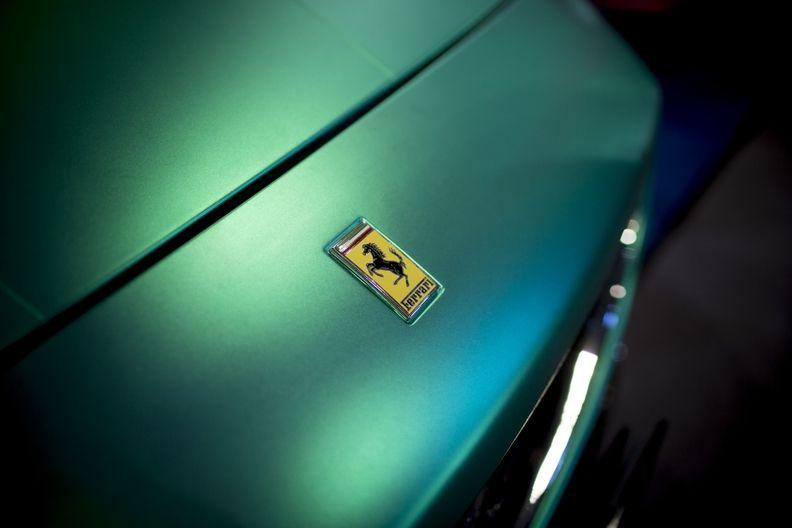 Ferrari logo on green hood