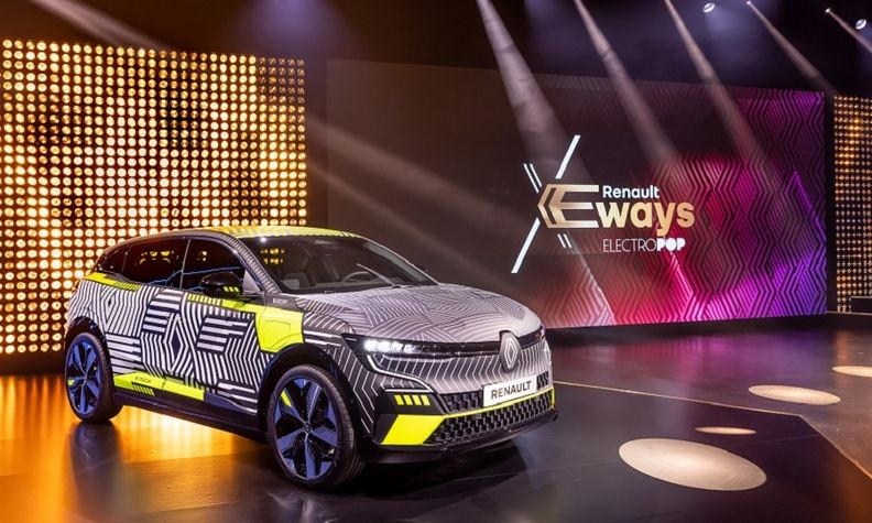 Renault will launch sales of an electric version of its Megane compact car next year. The EV is shown as a lightly camouflaged pre-production version.