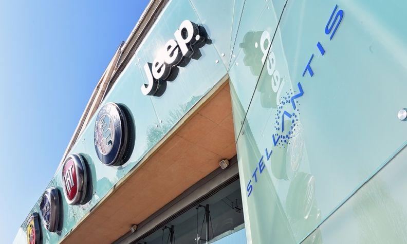 Stellantis, Jeep, Alfa Romeo, Fiat, Lancia and Abarth logos on building