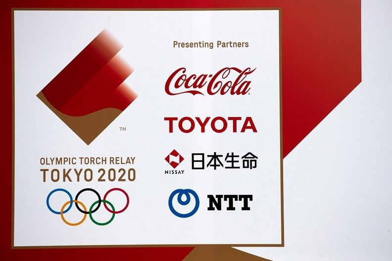 A banner advertising Olympic Games partners Toyota, Coca-Cola, Nissay and NTT.