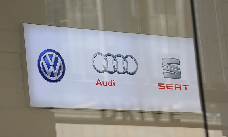 VW sign with brand logos